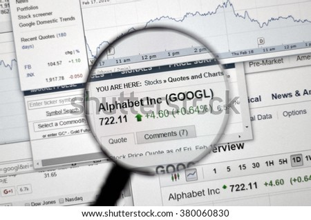 MONTREAL, CANADA - FEBRUARY, 2016 - S&P 500 stock market index on web page under magnifying glass.