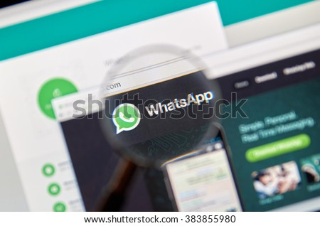 MONTREAL, CANADA - FEBRUARY, 2016 - Whatsapp on the web under magnifying glass. Whatsapp is one of the most popular messangers.