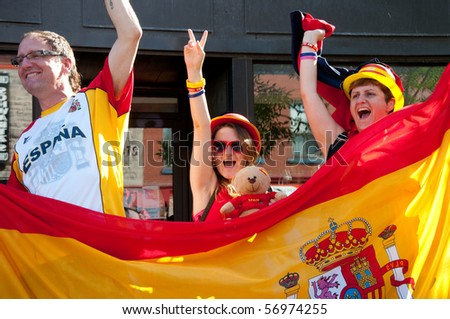 MONTREAL, CANADA - JULY 11: Celebrations in the streets of Montreal after Spain's victory at the FIFA World Cup.  July 11, 2010.  Montreal, Canada - stock photo