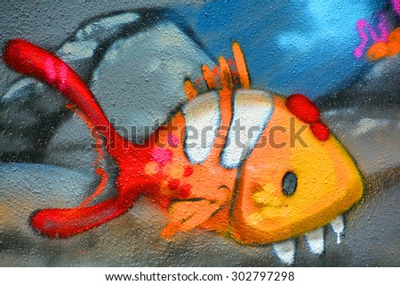 MONTREAL CANADA JULY 25 2015: Street art Montr�©al fish. Montreal is the perfect place to walk in the back alleys and abandoned areas, looking for street art. - stock photo