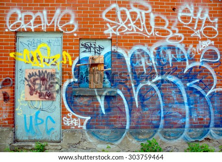 MONTREAL CANADA JULY 25 2015: Street art tag. Montreal is the perfect place to walk in the back alleys and abandoned areas, looking for street art.