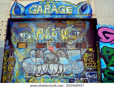 MONTREAL CANADA JULY 25 2015: Street art weird garage Montreal is the perfect place to walk in the back alleys and abandoned areas, looking for street art.