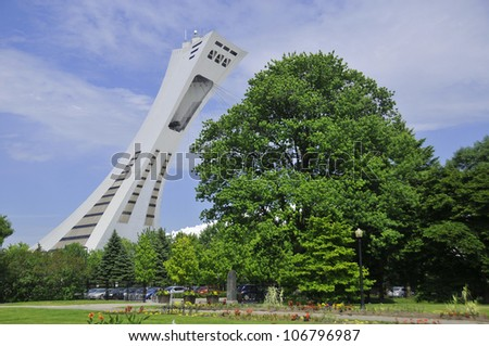 MONTREAL,CANADA -JUNE 24:The Montreal Olympic Stadium's  tower on June 24, 2012 in Montreal. It's the tallest inclined tower in the world.Tour Olympique stands 175 meters tall and at a 45-degree angle
