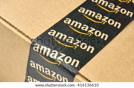 MONTREAL, CANADA - MARCH 10, 2016 - Amazon shipping box with branded tape on it. Amazon is one of the most popular and biggest online store. - stock photo