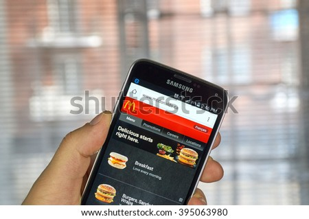 MONTREAL, CANADA - MARCH 20, 2016 - McDonald's  site on Samsung S5's screen. McDonald's is the world's largest chain of hamburger fast food restaurants. - stock photo
