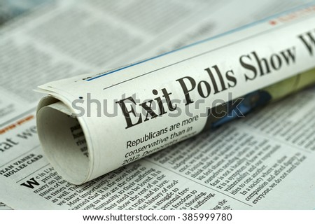 MONTREAL, CANADA - MARCH 3, 2016 - Rolled newspaper with Election 2016 article. The United States presidential election of 2016, scheduled for Tuesday, November 8, 2016. - stock photo