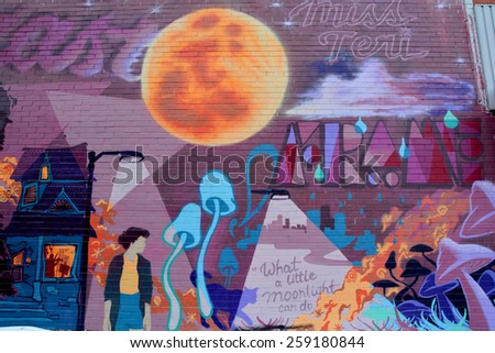MONTREAL CANADA MARCH 08: Street art Montreal full moon on march 08 2015 in Montreal Canada. Montreal. is the perfect place to walk in the back alleys and abandoned areas, looking for street art. - stock photo