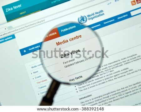MONTREAL, CANADA - MARCH  8, 2016 - Zika virus key facts on internet under magnifying glass. Zika virus is transmitted to people through the bite of an infected mosquito from the Aedes genus.