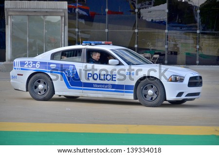 MONTREAL CANADA MAY 18: Car of the Service de police de la Ville de Montreal (SPVM) (French for Montreal Police Service) is the police force for the city of Montreal, Quebec, Canada on may 19 2013. - stock photo