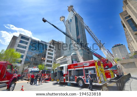 MONTREAL CANADA MAY 18: Fire engine on may 18 2014 in Montreal Canada. Service de securite incendie de Montreal the SIM is the 7th largest fire department in North America. - stock photo