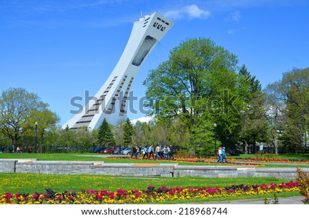 MONTREAL,CANADA - MAY 18.The Montreal Olympic Stadium and tower on may 18, 2014. It's the tallest inclined tower in the world.Tour Olympique stands 175 meters tall and at a 45-degree angle  - stock photo
