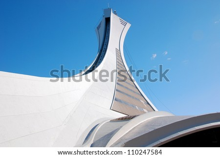 MONTREAL,CANADA - MAY 22. The Montreal Olympic Stadium tower on May, 22 , 2012. It's the tallest inclined tower in the world.Tour Olympique stands 175 meters tall and at a 45-degree angle - stock photo