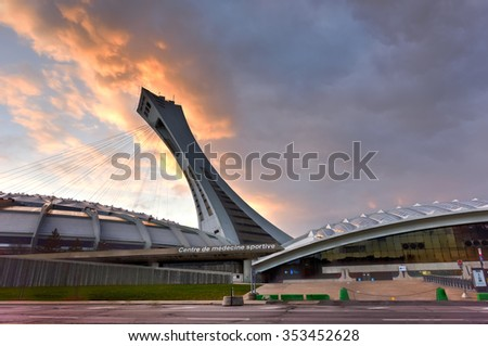 Montreal, Canada - November 29, 2015: The Montreal Olympic Stadium and tower at sunset. It's the tallest inclined tower in the world.Tour Olympique stands 175 meters tall and at a 45-degree angle. - stock photo