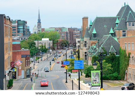 MONTREAL, CANADA - SEP 8: City street view with busy traffic on September 8, 2012 in Montreal, Canada. It is the largest city in Quebec, the second-largest in Canada and the 15th-largest in N America.