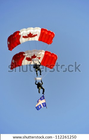 MONTREAL CANADA-SEPT. 02:Montreal military culture festival, SkyHawks, the Canadian Forces Parachute Team on Sept. 02 2012 in Montreal, Canada. The Great Military Montrealers from 1812-2012 exhibition - stock photo