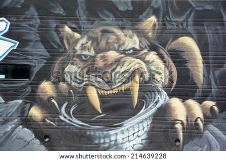 MONTREAL CANADA SEPT 01:Street art Montreal sabre-toothed tiger on sept 01 2014 in Montreal Canada. Montreal. is the perfect place to walk in the back alley and abandoned areas, looking for street art - stock photo