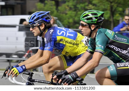 MONTREAL, CANADA-SEPTEMBER 09: A group of cyclists in action at 2012 UCI cycling calendar | 2012 Grand Prix Cycliste de Montreal on September 09, 2012 in Montreal, Mount royal climb - stock photo