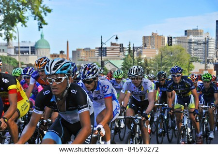 MONTREAL, CANADA-SEPTEMBER 11: An unidentified group of cyclists in action in 2011 UCI cycling calendar | 2011 Grand Prix Cycliste de Montréal on September 11, 2011 in Montreal, Mount royal climb