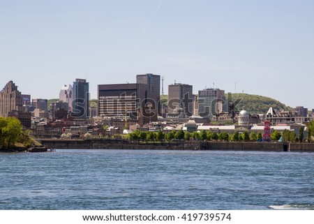MONTREAL CANADA - 17TH MAY 2015: A view of downtown Montreal during the day showing buildings, office and Montreal Port