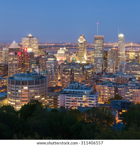 MONTREAL, CANADA - 18TH MAY 2015: A view of the Montreal Skyline at Dusk showing various buildings in the city