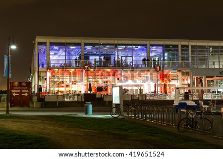 MONTREAL, CANADA - 17TH MAY 2015: The outside of Bars and Restaurants near the Old Port of Montreal at night. People can be seen.