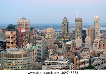 Montreal city skyline at sunset viewed from Mont Royal with urban skyscrapers. - stock photo