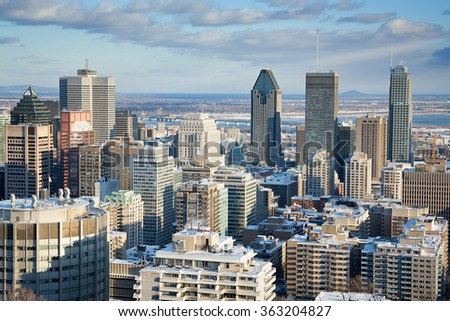 Montreal Financial District in winter, as seen from Mont Royal. Downtown district with St Lawrence River in the background. Early evening light.