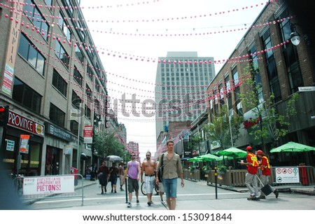 MONTREAL - JULY 8: Saint-Catherine street closed for the summer in the gay village on July 8, 2011.  - stock photo