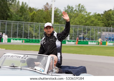 Montreal June 12, 2016. McLaren Honda F1 pilot Jenson Button waves at the crowd during driver's parade on race day at the Canadian Formula 1 Grand prix