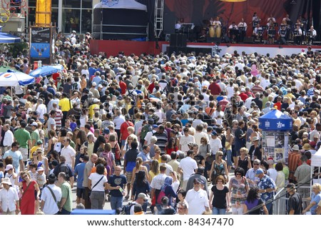 MONTREAL - JUNE 20: People dance during the open-air concert at the XXXV International Jazz Festival of Montreal on June 20, 2009 in Montreal, Canada - stock photo