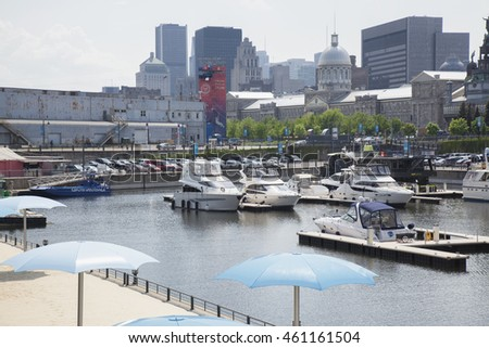 MONTREAL - MAY 27, 2016: The Old Port of Montreal is the historic port of Montreal, Quebec, Canada. It stretches for over two kilometres along the St-Lawrence River in Old Montreal.