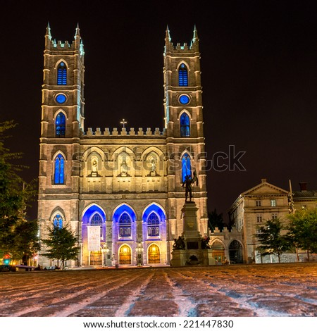 Montreal Notre Dame Basilica illuminated at night with stone texture - stock photo