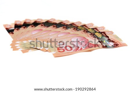 MONTREAL - NOVEMBER 19: Some Canadian fifty dollar bills are photographed on November 19, 2012 in Montreal, Quebec, Canada. - stock photo
