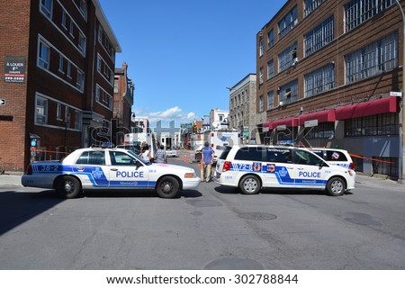MONTREAL OC CANADA AUGUST 02 2015: Crime scene of two men are dead and two others remain in critical condition after an overnight assault on Saint-Laurent Boulevard early Sunday morning. - stock photo