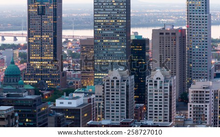 Montreal office buildings, and the church to the left of the image with a little digital noise at dusk. - stock photo
