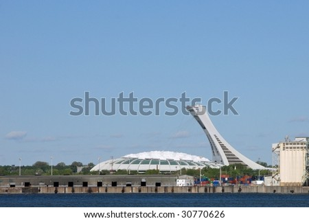 Montreal Olympic Stadium from across the St-Lawrence River - stock photo