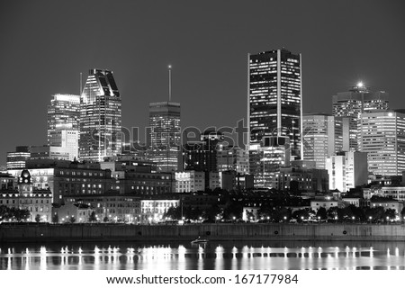 Montreal over river at dusk with city lights and urban buildings in black and white - stock photo