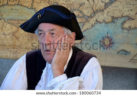 MONTREAL QUEBEC CANADA AUGUST 24: Man re-enacting New France era in Old Montreal, Pointe-a-Calliere's 18th Century Public Market on august 24 2013 in Montreal Canada - stock photo