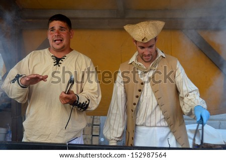 MONTREAL QUEBEC CANADA AUGUST 24: Men as cooks re-enacting New France period in Old Montreal, Pointe-a-Calliere's 18th Century Public Market on august 24 2013 in Montreal Canada - stock photo