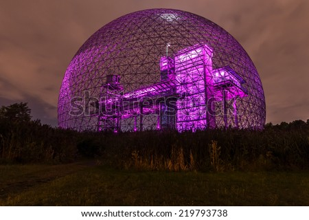 Montreal,Quebec,Canada-August 22-2012 Metallic Structure of Biosphere of Montreal This structure was in 1967 the Pavilion from the United States has the Montreal International Exhibition Purple. - stock photo
