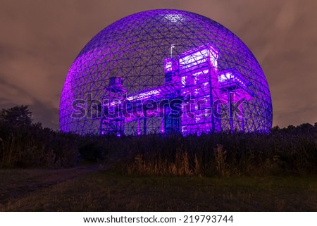 Montreal,Quebec,Canada-August 22-2012 Metallic Structure of Biosphere of Montreal This structure was in 1967 the Pavilion from the United States has the Montreal International Exhibition Purple Blue. - stock photo
