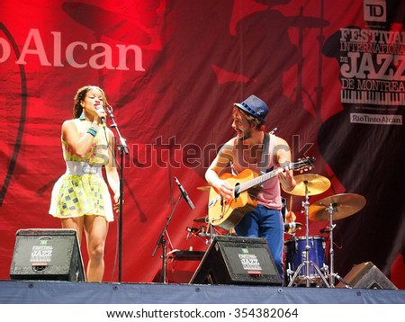 Montreal Quebec Canada - July 4 2015 - Ginkgoa from France concert Jazz International Festival . Swing Pop-Art music  Boston guitarist ,  French singer, female bass guitar,  clarinet player. - stock photo