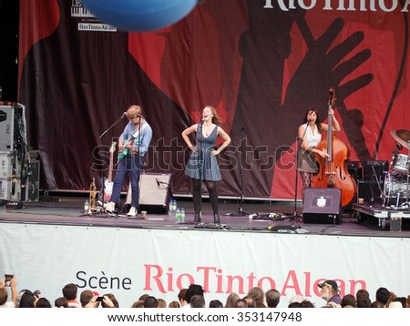 Montreal Quebec Canada - July 4 2014 - Lake Street Dive , the Boston jazz pop quartet with singer Rachel Price in concert Festival International Jazz outdoor stage - stock photo