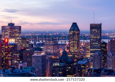 Montreal,Quebec,Canada-June 22-2010: Cityscape of Montreal, view from the mountain of Mont-Royal at Dusk - stock photo