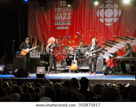 Montreal Quebec Canada - June 26 2015 Diana Fuchs female rock blues vocalist from US in performance on stage with her band at International Jazz Festival .