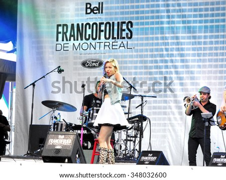 Montreal Quebec Canada - June 14 2015 - Festival Francofolies French music female vocalist Brigitte Boisjoli and her band on stage - stock photo