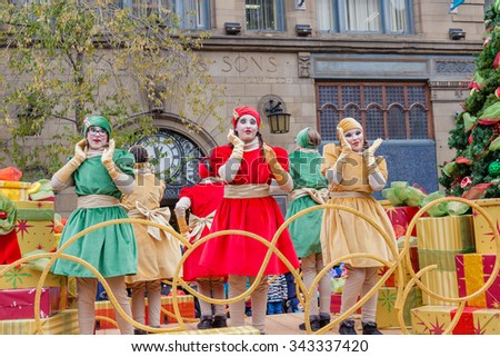 MONTREAL, QUEBEC, CANADA - NOVEMBER 21, 2015 : Dancing girls in the 65th edition of the Santa Claus Parade Destination Centre-ville (Defile du Pere Noel) along Saint Catherine Street. - stock photo
