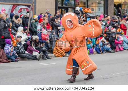 MONTREAL, QUEBEC, CANADA - NOVEMBER 21, 2015 : Man in Ginger Bread Man costume in 65th edition of the Santa Claus Parade Destination Centre-ville (Defile du Pere Noel) along Saint Catherine Street. - stock photo