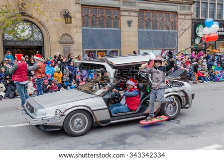 MONTREAL, QUEBEC, CANADA - NOVEMBER 21, 2015 : Marty McFly with DeLorean in the 65th edition of the Santa Claus Parade Destination Centre-ville (Defile du Pere Noel) along Saint Catherine Street. - stock photo