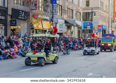 MONTREAL, QUEBEC, CANADA - NOVEMBER 21, 2015 : Paramedics at the beginning of the 65th edition of the Santa Claus Parade Destination Centre-ville (Defile du Pere Noel) along Saint Catherine Street. - stock photo